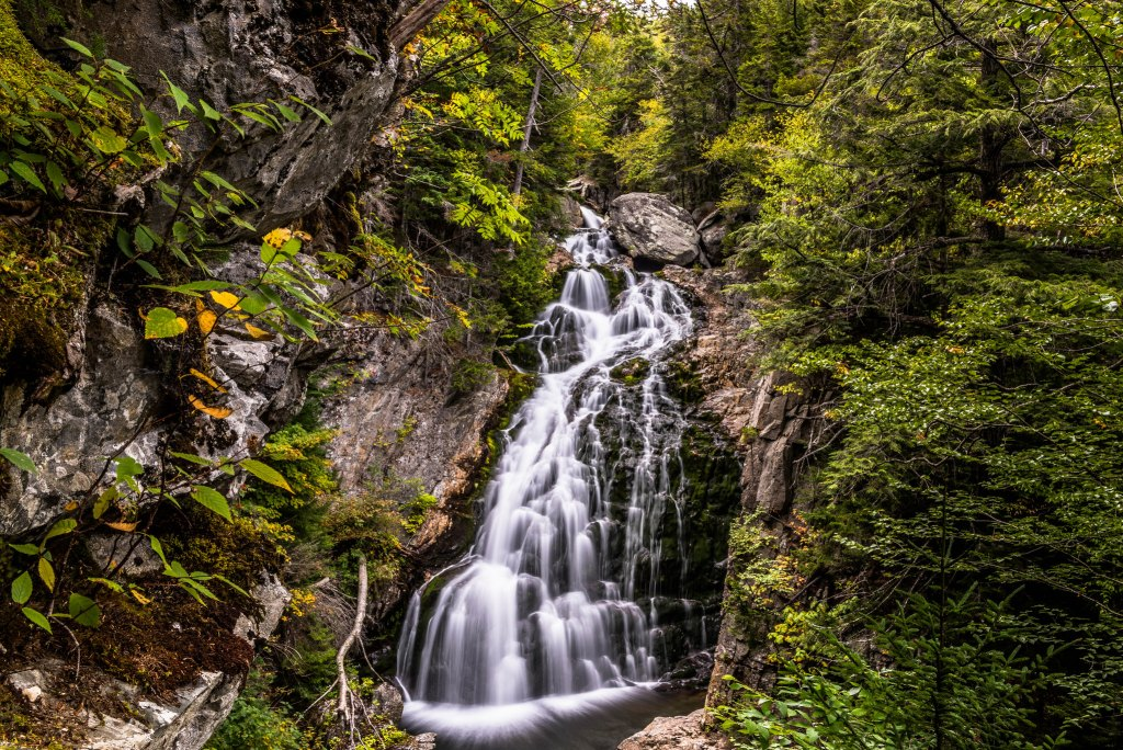 Cascading waterfall in White Mountain National Forest, New Hampshire, a great weekend retreat from Boston.