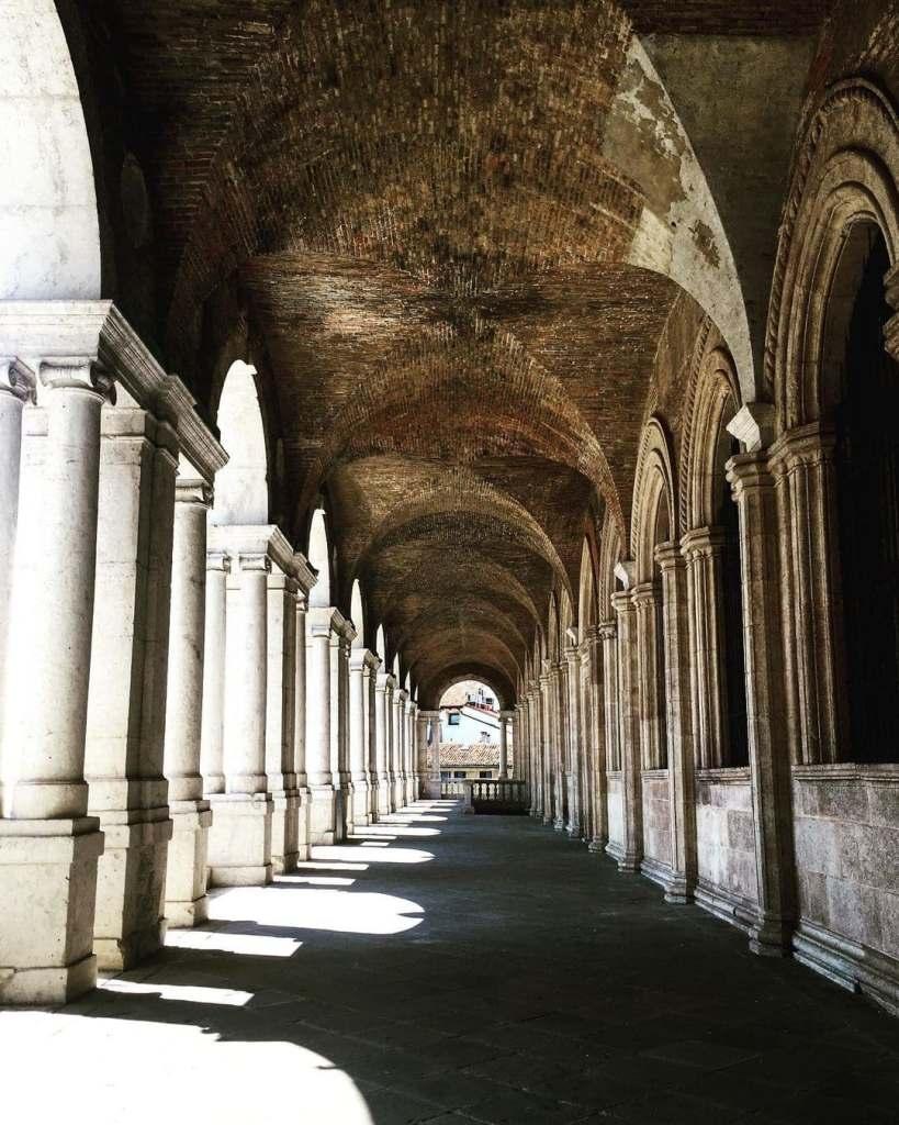 Shadows and light coming through columns at Basilica Palladiana in Vicenza, Italy.