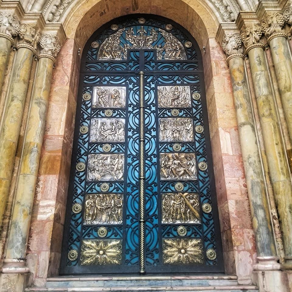 Large turquoise door in Cuenca, Ecuador.
