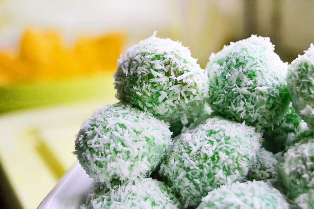 Green balls of Klepon, a traditional Indonesian candy.
