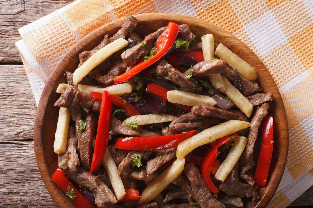 Close-up of lomo saltado, a traditional Peruvian dish that you can easily create in your own kitchen with this virtual cooking class.