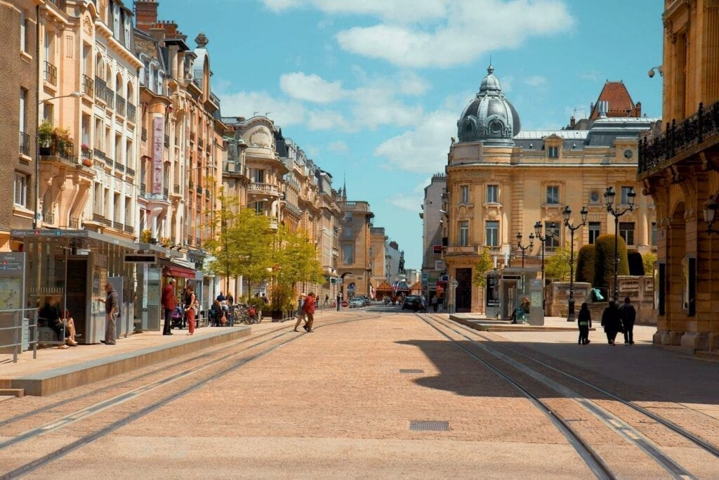 Reims city center with beautiful architecture and many people walking around.