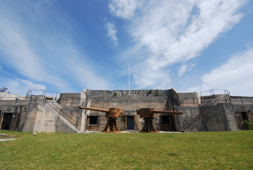 Two old cannons pointing in opposite directions in front of Alexandra Battery on the island of St. George in Bermuda
