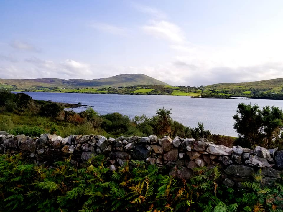 Stone wall and lake in Connemara National Park, easy day trip from Galway Ireland
