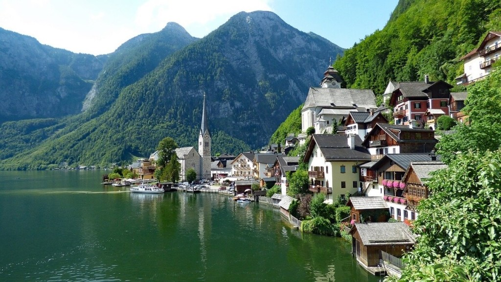 Buildings, mountains, and lake in Hallstatt, Austria - one of the most beautiful places on the planet and a great day trip from Vienna.