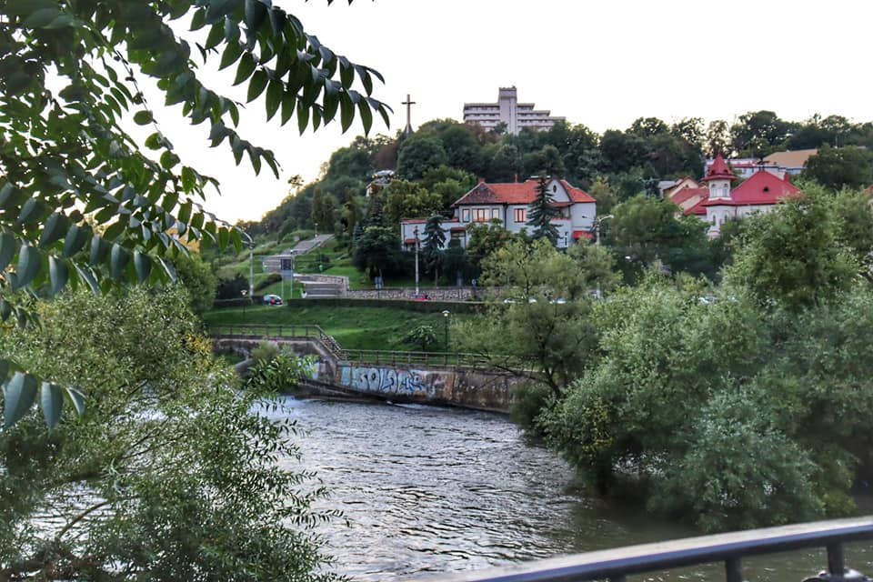 View of the Somes River and the Belvedere Hotel in Cluj-Napoca, Romania