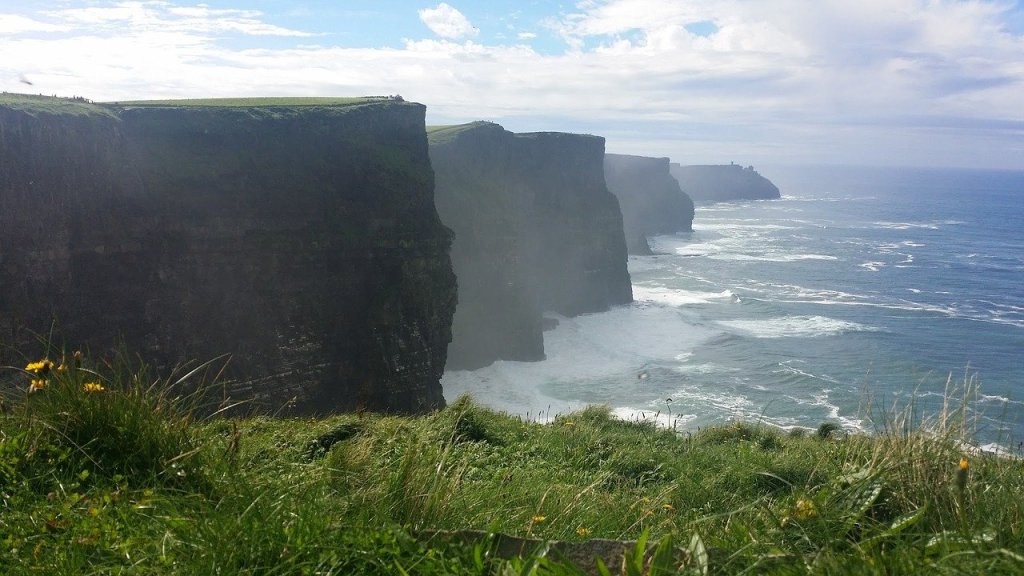 Cliffs of Moher in Ireland seen on a misty day by the ocean.
