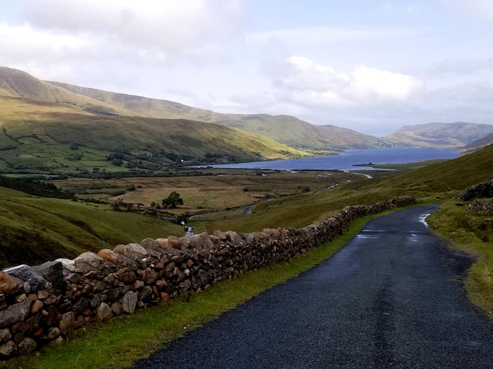 Empty road next to a lake in Connemara National Park, Ireland