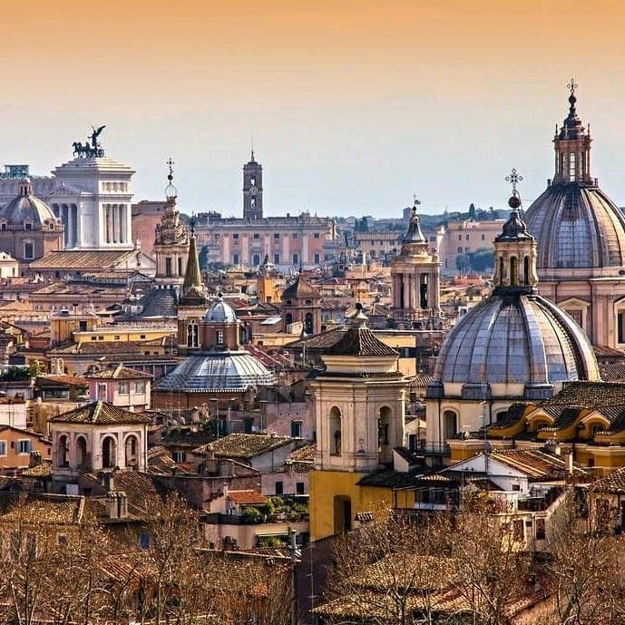 View of domed buildings and the top of Altare della Patria as seen from Gianicolo hill in Rome, Italy.