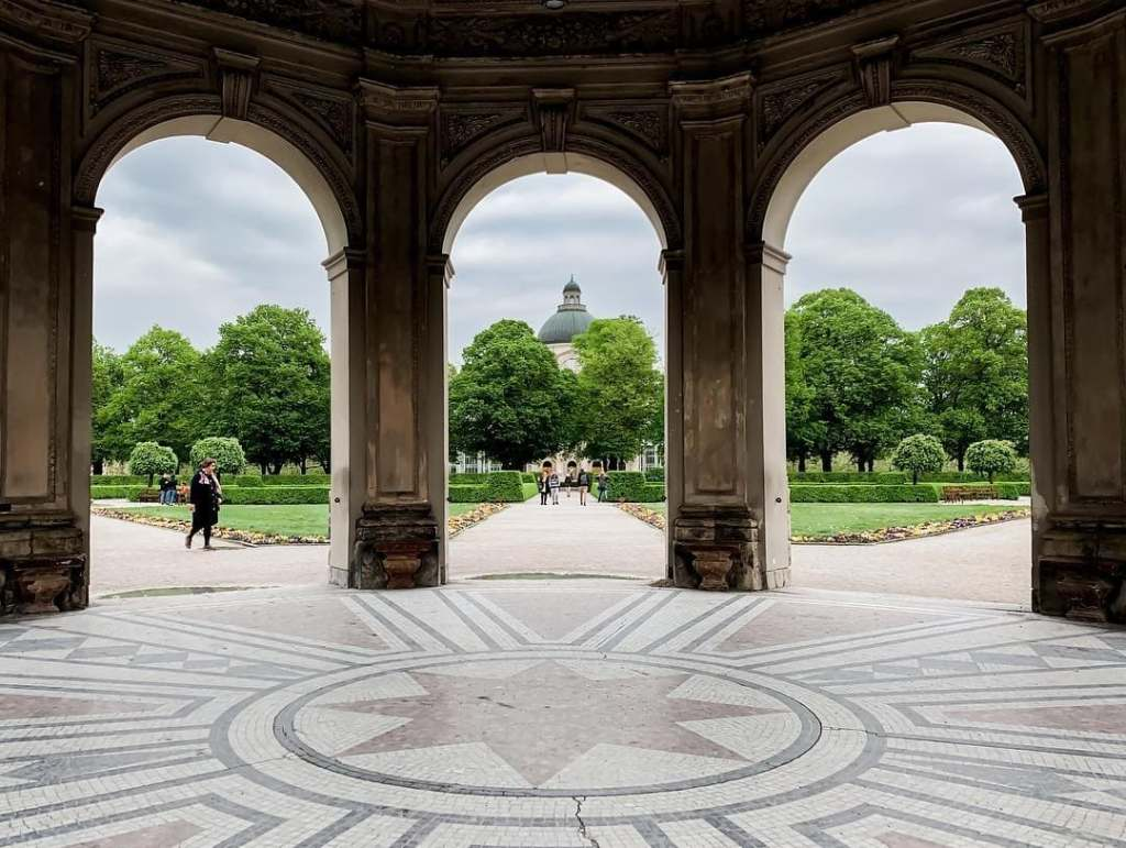 Looking through the arches at Hofgarden in Munich, Germany during springtime.