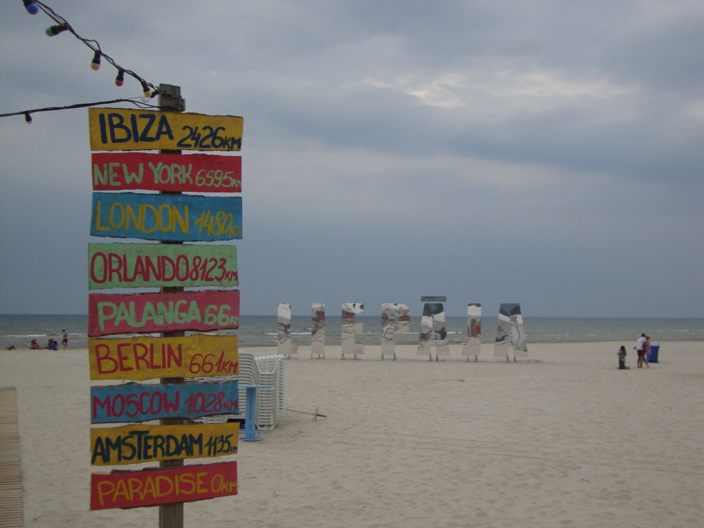 Signs on the beach in Liepaja, Latvia, an underrated beach destination