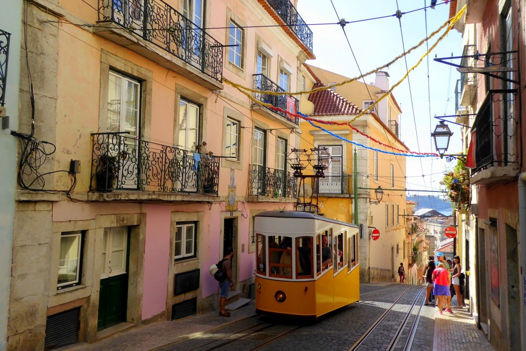 Trolley in the pastel colored streets of Lisbon.