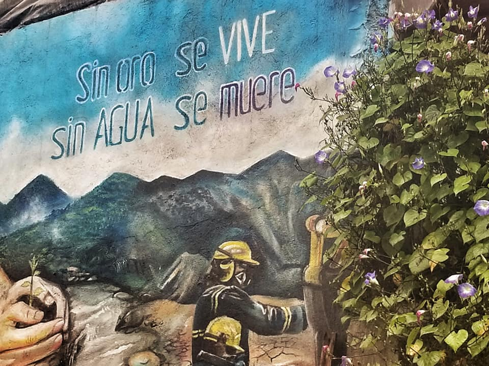 Street art depicting firefighters in the cloud forest - sin oro se vive, sin ague se muere