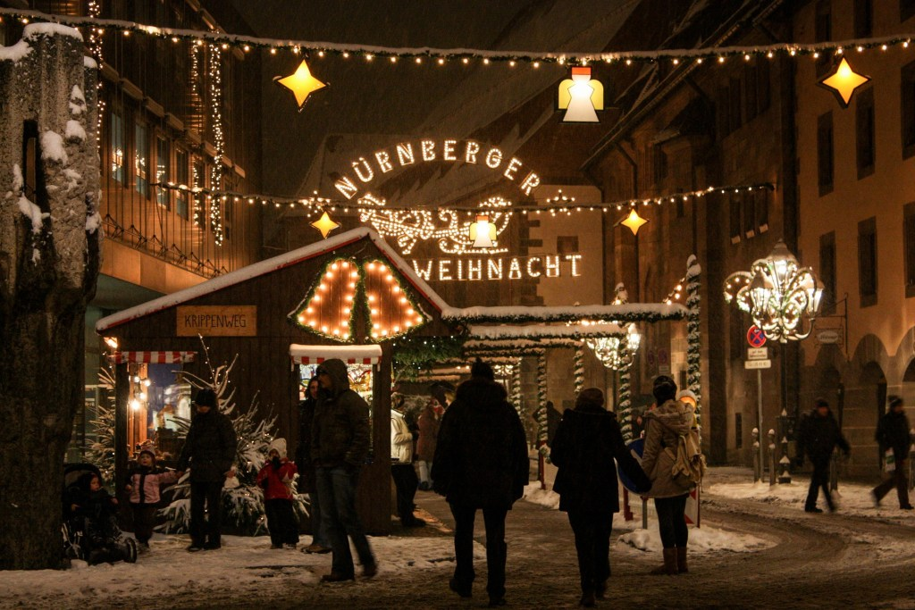 People walking around at night in Nuremburg's Christmas Market.