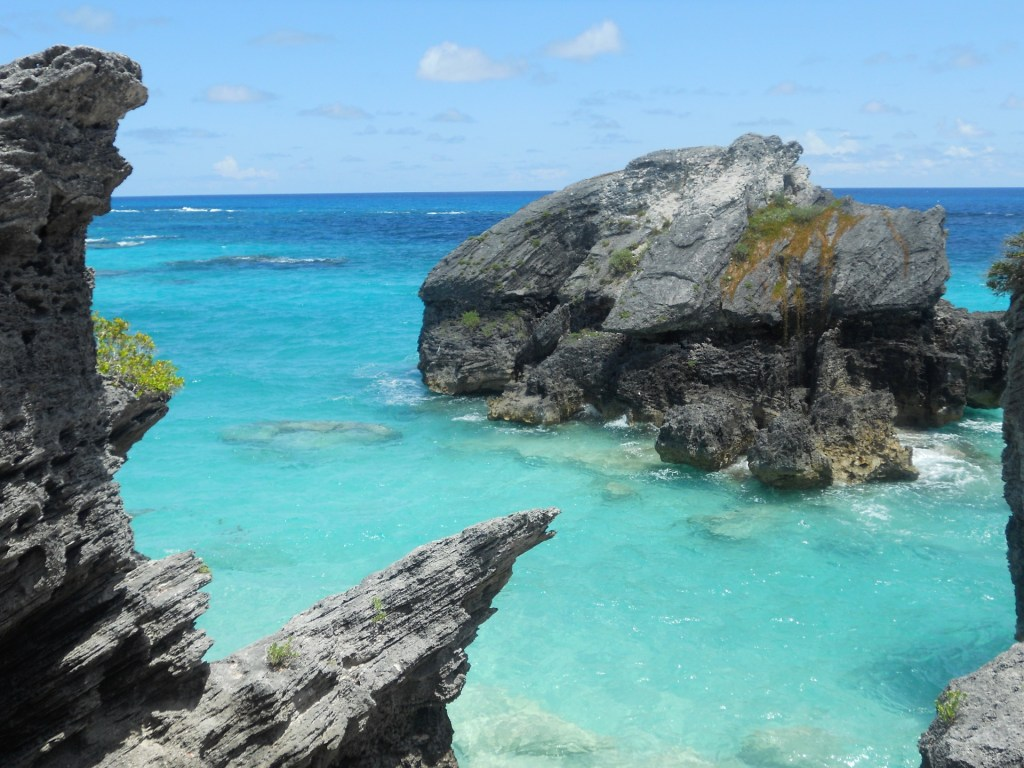 Tobacco Bay, Bermuda with rocks jutting out of the water and from the coast.