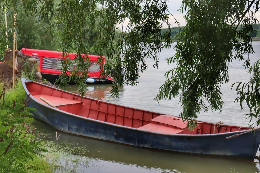 Old boats on the shore of the Danube River at its Delta in Romania