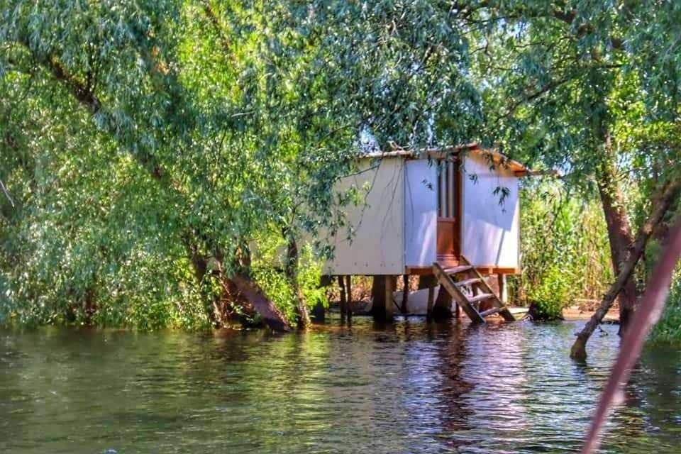 Raised hut above the water at the Danube Delta, Romania