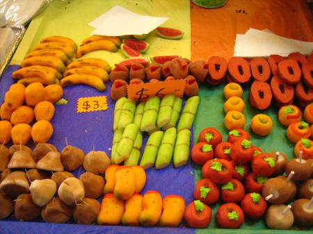 Tiny pieces of fruit, molded from dulce de leche, sold at the Feria de Alfeñique in Toluca, Mexico