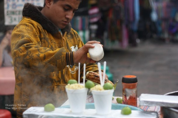 Salting elote near the Alameda Central, Mexico City.