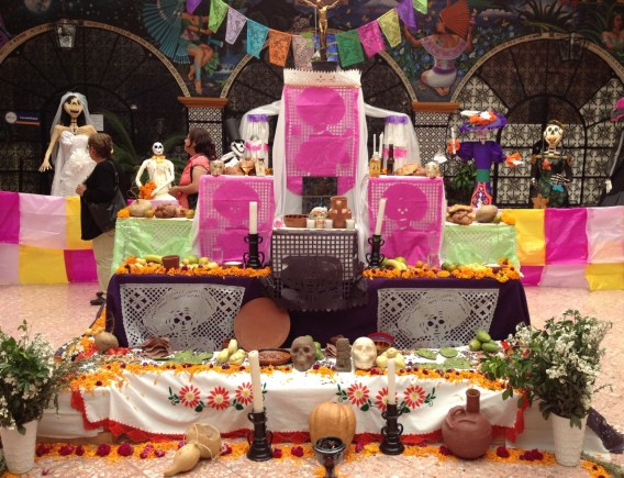 This Atlixco altar has a few more savory items -- notice the nopal and chayote on the bottom level.