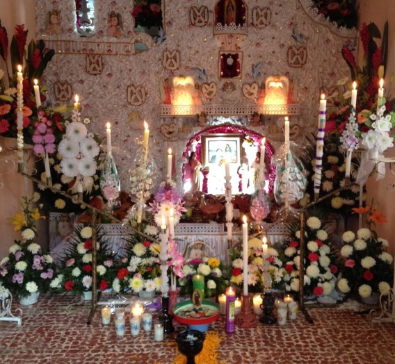 An altar in Huaquechula, Puebla. The pretzel-shaped bread is a common theme.