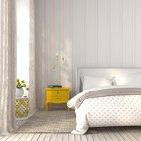 Light bedroom with yellow bedside table