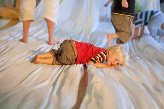 Toddlers on blanket - Battle for the nap room