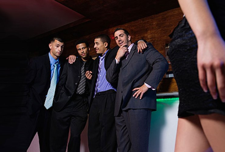 Men checking out a woman's butt