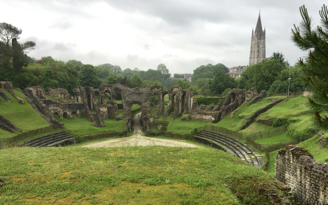 The Gallo-Roman Amphitheatre in Saintes, France, with the Cathedral Saint-Pierre in the distance.