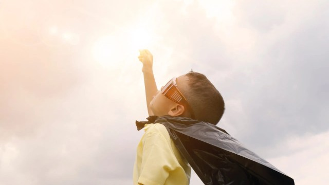 Image- Child dressed like  super hero.