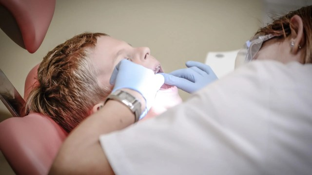Image of Child with teeth being examined- Finding the Perfect Dentist for a Loved One with Special Needs