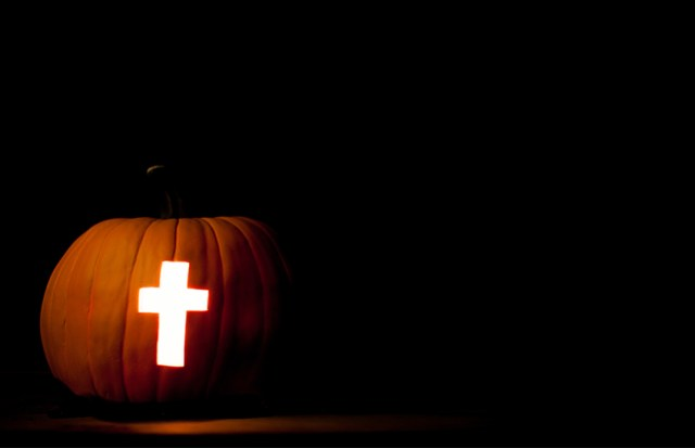 A cross carved into jack o lantern