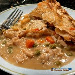 Classic chicken pot pie with roasted chicken, carrots, celery, onions, sweet peas in a warm creamy sauce, covered with a light flaky crust. Comfort food!   TheMountainKitchen.com