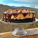 Rich, thick and sinfully indulgent, this Reese's Peanut Butter Cheesecake has a cookie crust with creamy peanut butter cups topped with a chocolate ganache. | TheMountainKitchen.com