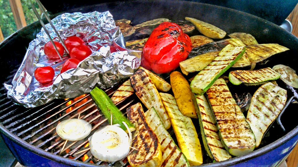 Summer squash, eggplant, zucchini, bell pepper, mushrooms and tomatoes all grilled to make a warm grilled vegetable salad with bread and dressing. | TheMountainKitchen.com