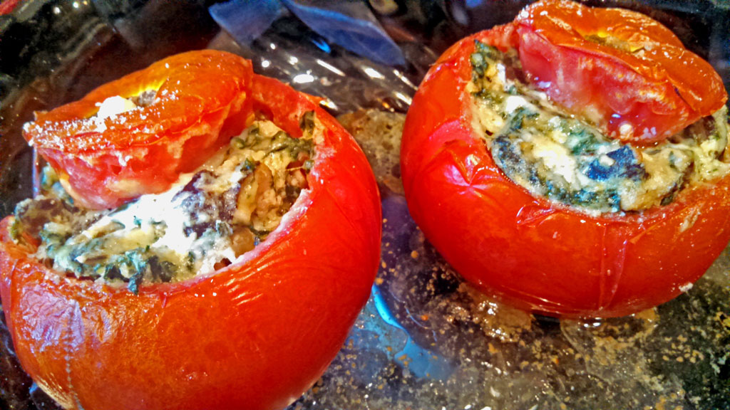 These vegetarian stuffed tomatoes are so yummy! Beefsteak tomatoes stuffed with mushrooms, spinach and ricotta cheese, served with a fresh dijon dressing. | TheMountainKitchen.com