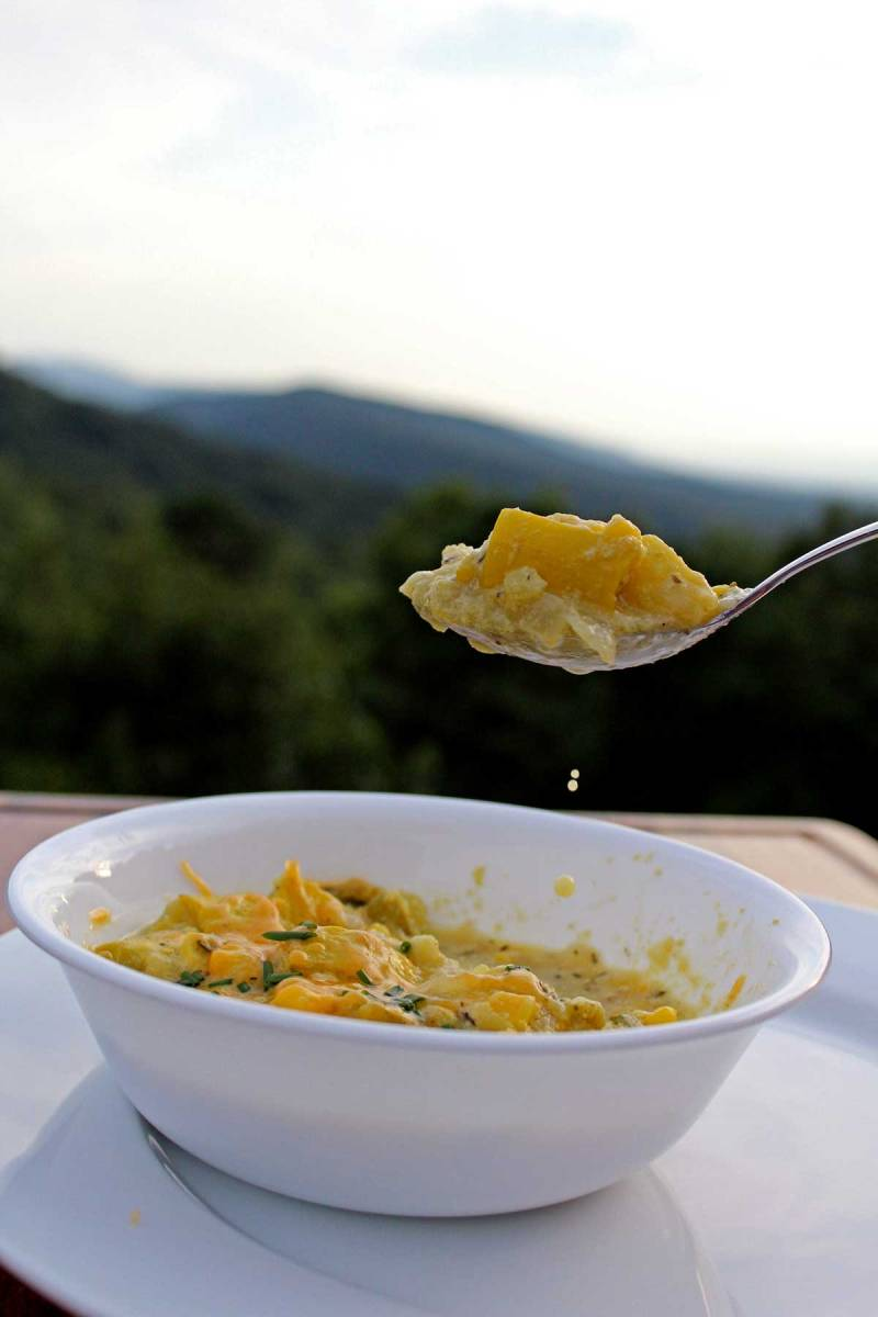 a spoon full of corn chowder with mountain view