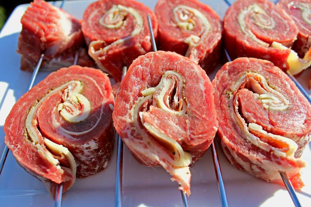 Grilled stuffed flank steak is ajuicy steak rolled into a pinwheel with rich garlicky Italian meat, cheese and herbs, on a skewer. Italian Meat Lollipops! | TheMountainKitchen.com