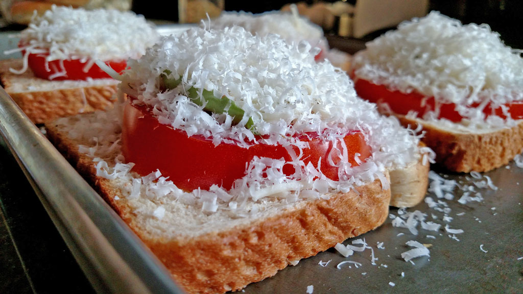 cheese piled up on to of the caprese sandwiches