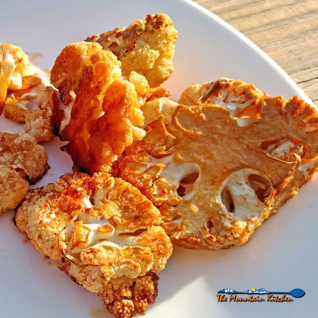 """This recipe for sriracha roasted cauliflower uses delicious cauliflower, with a kick, kind of like a """"meatless buffalo wing"""" for Meatless Monday. 