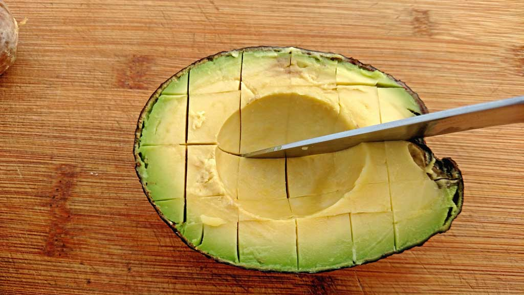 Slicing an avocado is tricky if you don't know a few simple tips to keep them from squishing around. Learn how to cut peel and slice an avocado. | TheMountainKitchen.com