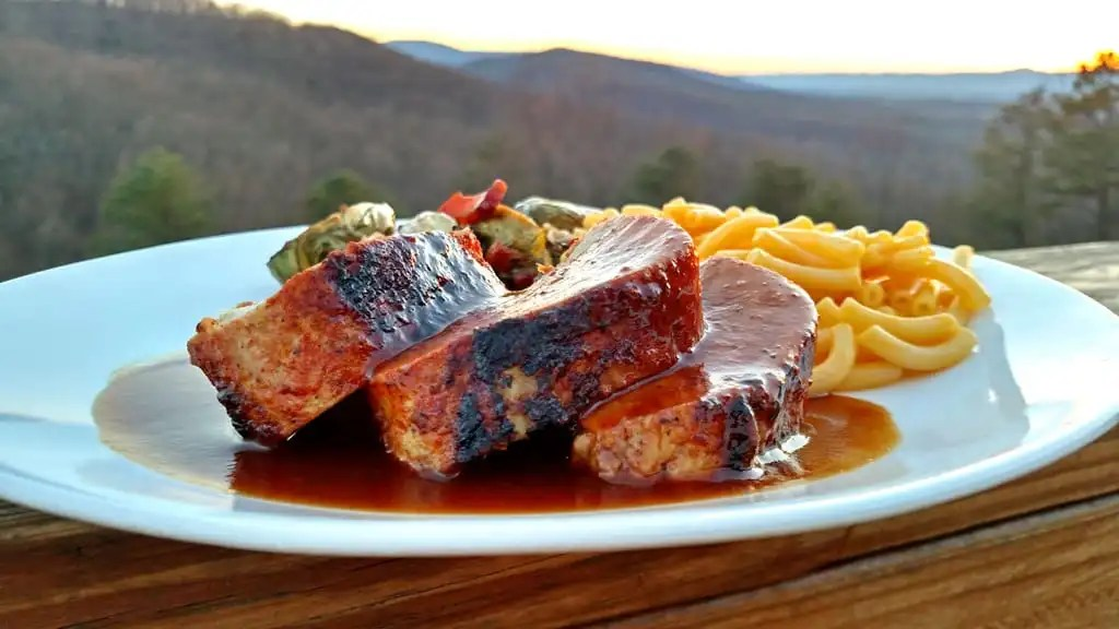 Lean, moist, and incredibly succulent, Oven-Baked BBQ Pork Tenderloin is seasoned with a blend of sweet, warm, savory spices, and smothered in BBQ sauce. | TheMountainKitchen.com