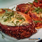 This classic Italian-American Parmesan Chicken is made breaded in parmesan crust, fried golden brown, topped with tomato sauce topped with melted cheese! | TheMountainKitchen.com