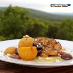 Greek-Style Lemon Garlic Chicken - This flavorful Greek-Style dish features tender juicy chicken thighs with potatoes, olives and garlic, roasted in a warm bath of olive oil, lemon juice and oregano, served with tangy crumbled feta cheese. | TheMountainKitchen.com