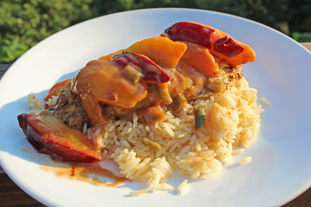 Jerk Chicken with Spicy Peach and Plum Coconut Sauce   Easy to make, this chicken rubbed with jerk seasoning, topped with a deliciously spicy peach and plum coconut sauce over Jasmine Rice is made in minutes.
