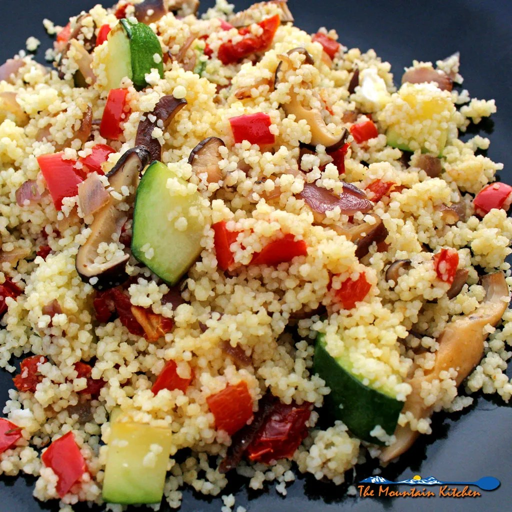 This Summer Vegetable Couscous Salad is a quick, hearty and versatile way to prepare couscous with summer vegetables to make as a meal or side dish to accompany any summer meal. | TheMountainKitchen.com