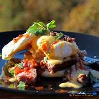 Steak eggs Benedict with chipotle-lime Hollandaise sauce is a spicy twist on traditional eggs Benedict, with leftover steak, lime and chipotle adobo. | TheMountainKitchen.com
