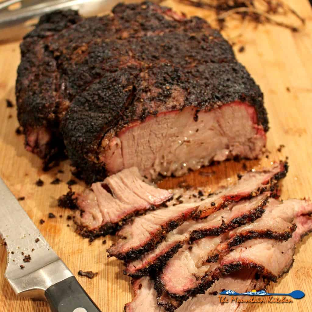 This smoked chuck roast is cheaper than prime rib, easier to get along with than brisket and it is a whole lot easier to come by in the grocery store. | TheMountainKitchen.com