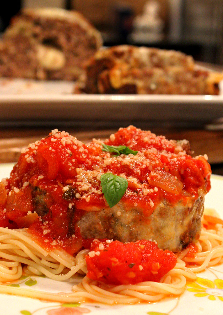 Wow! Take meatloaf to a whole new level, by adding Italian flavors to traditional meatloaf. This tender and delicious Italian Meatloaf is stuffed with cheese and smothered in tomato sauce.    TheMountainKitchen.com