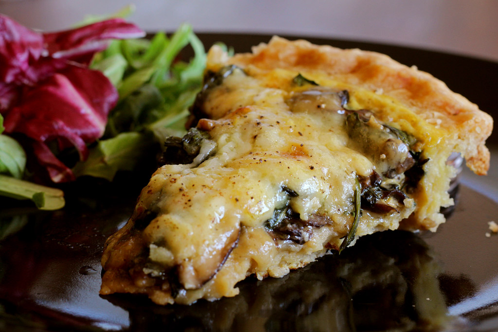 This easy to prepare Mushroom Spinach Quiche is made with mushrooms, spinach, shallots and Gruyere cheese. Great for breakfast, lunch or dinner! | TheMountainKitchen.com